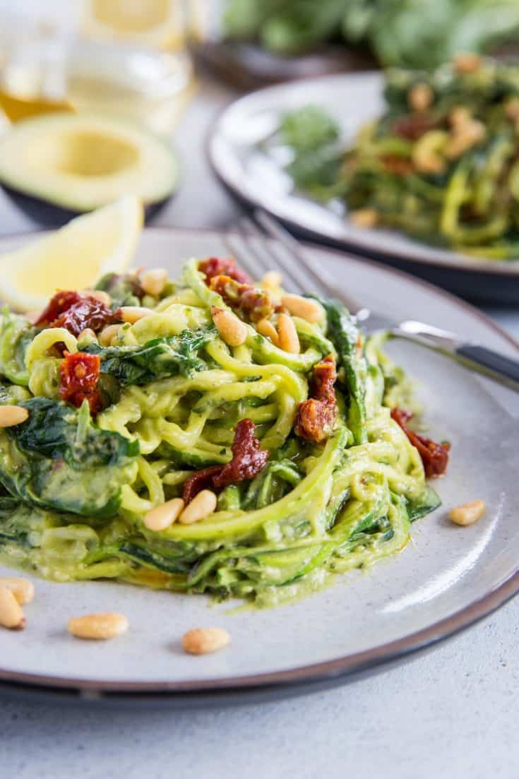 Avocado pesto zoodles with dried tomatoes and spinach